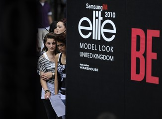 Young women wait to take part in an event organised by the 'Elite Model Look' agency, in Covent Garden, in central London