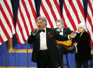 "Tony Orlando sings for U.S. President Donald Trump and his wife first lady Melania Trump at the ""Salute to Our Armed Forces"" inaugural ball during inauguration festivites in Washington"