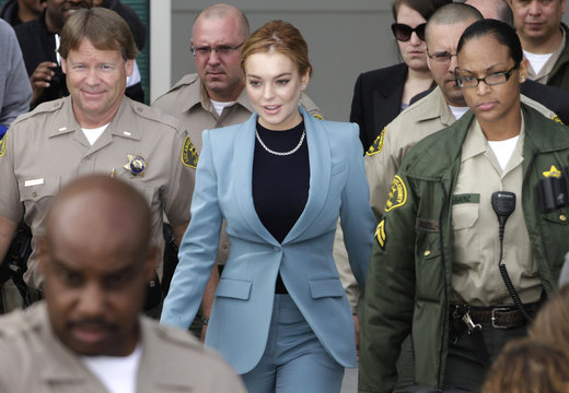 Actress Lindsay Lohan departs a hearing in her DUI case at Airport Branch Courthouse in Los Angeles, California