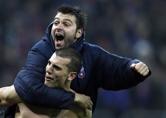 Nikolic and Rusescu of Steaua Bucharest celebrate their team victory against AEK Larnaca during their Europa League Group J soccer match in Bucharest