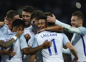 England's Adam Lallana celebrates scoring their first goal with team mates