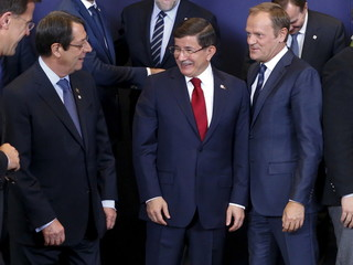 Cyprus President Nicos Anastasiades Turkish Prime Minister Davutoglu and European Council President Tusk take part in a group photo at a EU-Turkey summit in Brussels
