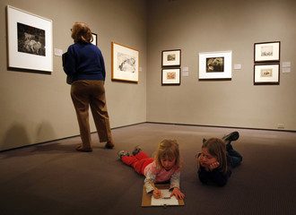 """Two girls make a drawing in the """"Paper Zoo"""" exhibit at the Museum of Fine Arts, Boston during school vacation week in Boston"""