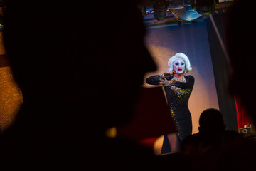 People watch as a drag queen takes part in a performance at Mayak, a gay cabaret club in Sochi
