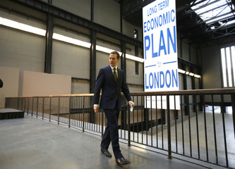 Britain's Chancellor of the Exchequer George Osborne leaves after announcing his Long Term Economic Plan for London at the Tate Modern in London