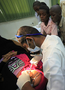 Dentist and CEO of Khartoum Dental Clinic Dr Fadil Elamin teaches oral hygiene to children from Khalwas of the Jabel Awlia district in Khartoum