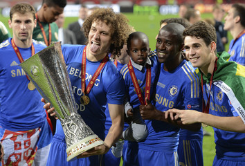 Chelsea players celebrate with the trophy after defeating Benfica in their Europa League final soccer match at the Amsterdam Arena