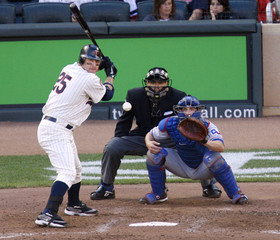 Minnesota Twins Jim Thome takes a ball to draw a walk off Texas Rangers pitcher Rich Harden in Minneapolis