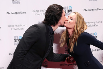 Actor Adam Driver kisses actor Leslie Mann as he arrives on the red carpet at the 2016 IFP Gotham Independent Film Awards in Manhattan, New York