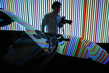 A photographer walks past Kia Motor's The New Soul during its unveiling ceremony in Seoul