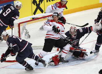 Canada's Skinner challenges goalkeeper Howard of the U.S. and Braun during their 2012 IIHF ice hockey World Championship game in Helsinki