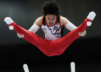 Uchimura of Japan performs on the parallel bars during the men's individual all-around final at the Artistic Gymnastics World Championships in Rotterdam