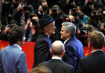 "Director and actor Clooney and cast member Murray arrive for a screening of the movie ""The Monuments Men"" during the 64th Berlinale International Film Festival in Berlin"