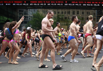 Participants of 'Strut the Streets', an annual swimwear parade, march through Martin Place in central Sydney