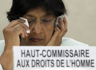 United Nations High Commissioner for Human Rights Pillay wipes her eye during 18th session of the Human Rights Council at the UN in Geneva