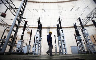 A worker walks as he checks the components of an electro turbine in Elektroprivreda's hydropower plant in Trebinje