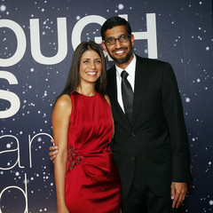 Sundar Pichai, Google's senior vice president of Android, Chrome and Apps, and a guest arrive on the red carpet during the 2nd annual Breakthrough Prize Award in Mountain View