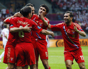Russia's players celebrate a goal against Poland during their Group A Euro 2012 soccer match at national stadium in Warsaw