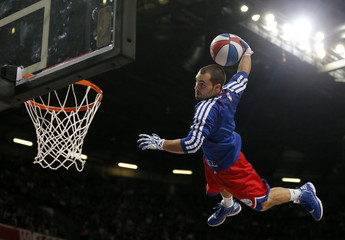 An entertainer dunks the ball before a NBA preseason basketball game between the Oklahoma City Thunder and the Philadelphia 76ers in Manchester