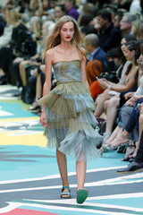 Model Plowden presents a creation from the Burberry Prorsum Spring/Summer 2015 collection during London Fashion Week