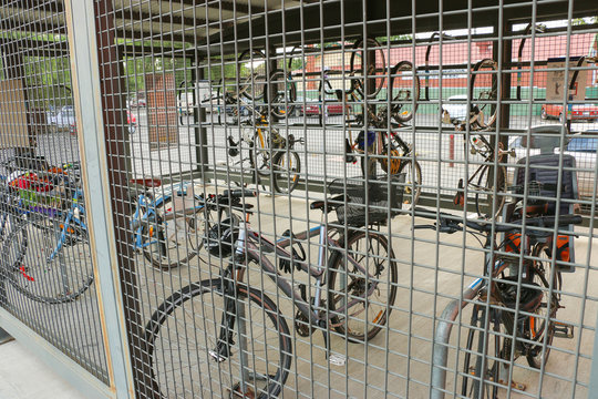 bicycles in a locker or cage at a railway station