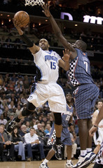 Orlando Magic guard Carter drives the ball against Charlotte Bobcats center Diop during their NBA basketball game in Charlotte