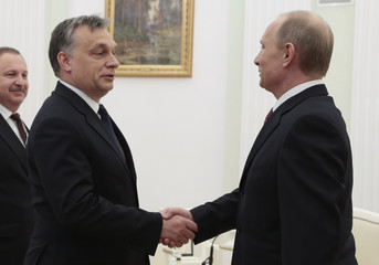 Russia's President Putin and Hungary's Prime Minister Orban shake hands during their meeting in the Kremlin in Moscow