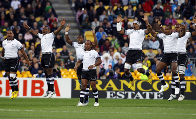 Fiji players jump at the end of their Cibi before their Rugby World Cup Pool D match against South Africa Springboks at Wellington Regional Stadium in Wellington