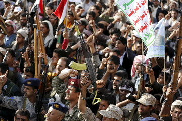 Followers of the Houthi group demonstrate against the Saudi-led air strikes on Yemen, in Sanaa
