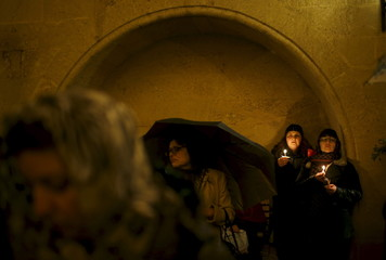 Worshippers hold lit candles during an Orthodox Easter service at Sioni cathedral in Tbilisi