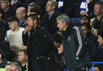 Chelsea's coach Mourinho and Atletico's coach Simeone watch their Champions League semi-final second leg soccer match at Stamford Bridge in London