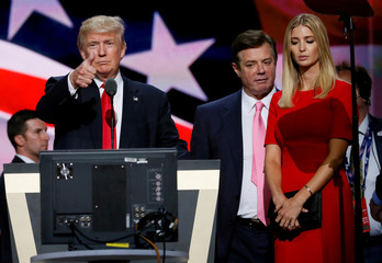 Republican presidential nominee Donald Trump gives a thumbs up as his campaign manager Paul Manafort and daughter Ivanka look on during Trump's walk through at the Republican National Convention in Cleveland