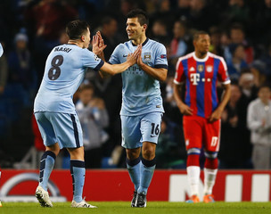 Manchester City's Aguero celebrates with Nasri after he scored a goal against Bayern Munich during their Champions League Group E soccer match in Manchester