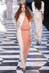 A model presents a creation by Dutch designers Viktor and Rolf as part of their Spring/Summer 2013 women's ready-to-wear fashion show during Paris fashion week
