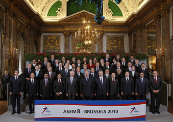 Leaders and Foreign Ministers from Asia and the European Union pose for a family photo with Belgian King Albert during a ASEM in Brussels
