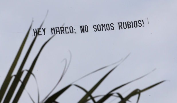 A banner pulled by a small airplane is shown as it flies above The Doral Resort