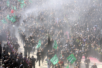 Shi'ite pilgrims run between the Imam Hussein and Imam Abbas shrines as part of a ritual of the Ashura ceremony in Kerbala