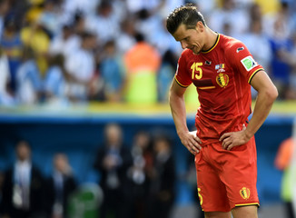 Belgium's Van Buyten reacts after the team's 2014 World Cup quarter-finals against Argentina at the Brasilia national stadium in Brasilia