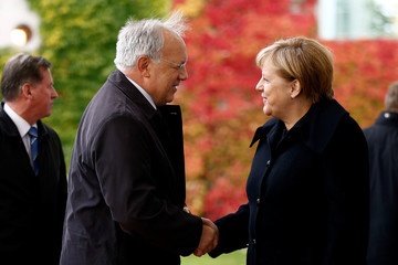 German Chancellor Merkel and President of Switzerland Schneider-Ammann review the honour guard during a welcoming ceremony at the chancellery in Berlin