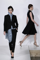 A model presents a creation by Georgian designers of Atelie 10a during Tbilisi Fashion Week