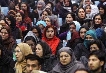 Supporters of Afghan presidential candidate Zalmai Rassoul listen to his speech during the presidential campaign in Kabul