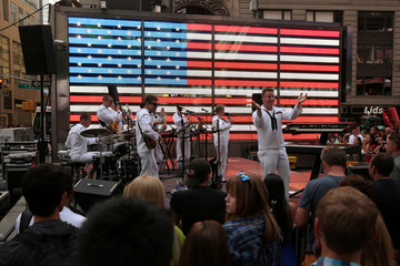 Members of the Rhode Island Navy Northeast band perform on stage during Fleet Week in Times Square in the Manhattan borough of New York
