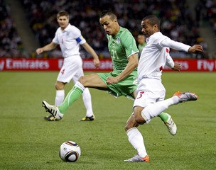 Algeria's Kadir fights for the ball with England's Cole during a 2010 World Cup Group C soccer match at Green Point stadium in Cape Town