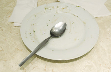 An empty plate is left at a table following a Pie and Mash Club meeting at G. Kelly's pie and mash shop in east London