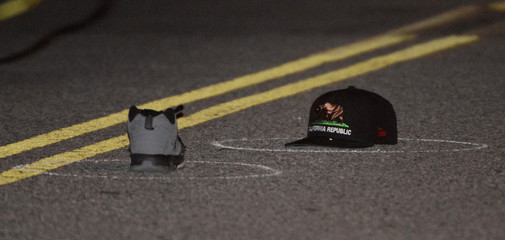 A shoe and hat sit on the pavement at the scene where a celebrity photographer was struck and killed by a car in Los Angeles