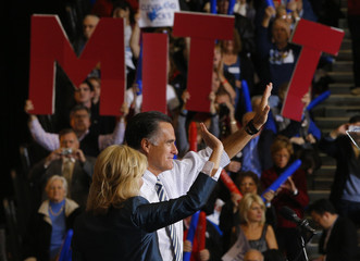 Republican presidential nominee Romney and his wife Ann wave to the crowd at a campaign rally in Cleveland