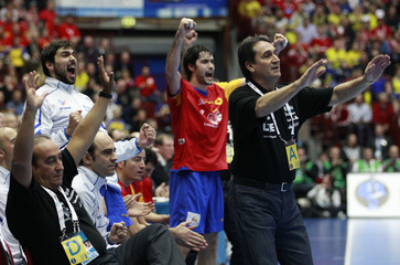 Spain's head coach Lopez and players from the bench react during the bronze medal game against Sweden at the Men's Handball World Championship in Malmo