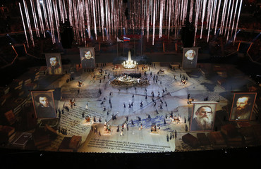 Pictures of Russian writers and poets are seen as performers take part in the closing ceremony for the 2014 Sochi Winter Olympics