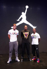 NBA basketball players Anthony of New York Knicks, Paul and Griffin of Los Angeles Clippers pose for photographs in front of a Jordan Brand logo during a promotional event in Beijing