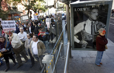 People take part in a rally on the eve of the International Day for the Eradication of Poverty in Madrid